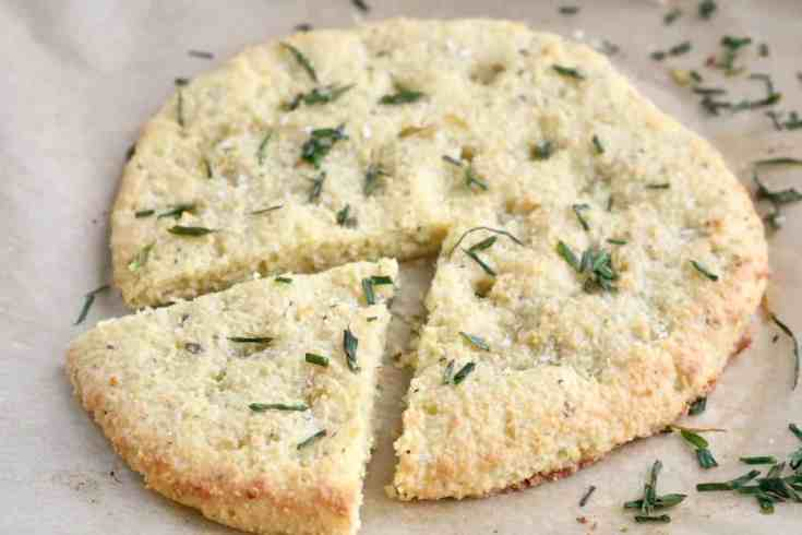 Easy low-carb, gluten-free focaccia bread made with almond flour that is crispy in all the right places, soft on the inside with garlic and herbs running through it and all topped with warm olive oil, sea salt and chives. Keto-friendly and ready in 15 minutes! #ketobread, #lowcarbfocaccia, #gluten-freebread, #almond flour, #15minuterecipes