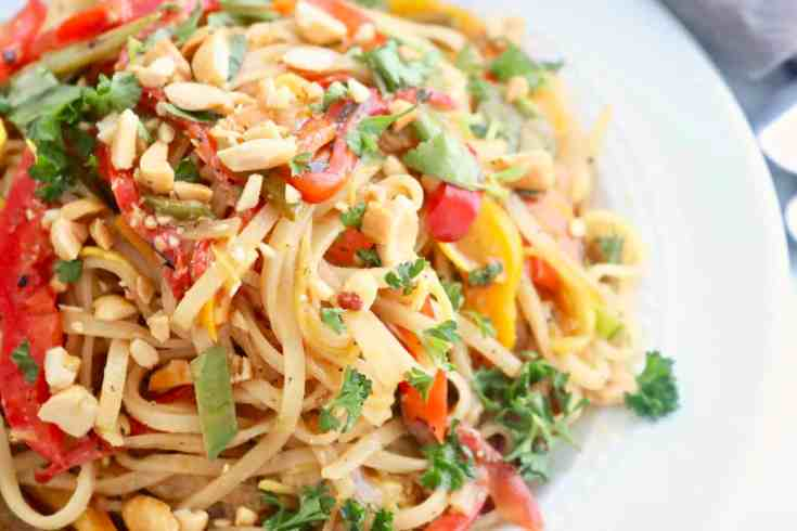Soft rice noodles mixed with sautéed veggies, eggs and an incredible pad thai sauce that you have to make! Vegetarian, gluten-free and the perfect date night in meal for two! Comes together in less than 20 minutes. So Easy and so good! #vegetarianpadthai, #easypadthairecipe, #healthyvegetarianrecipes, #padthainoodles, #asianrecipes