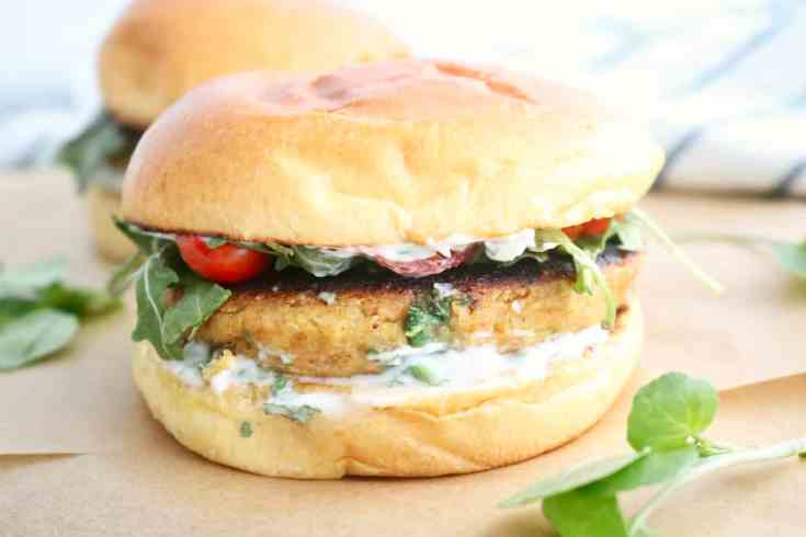 Perfectly seasoned, roasted cauliflower, protein packed chickpeas, fluffy quinoa, egg, parmesan, breadcrumbs, garlic powder, chili powder and olive oil all mixed up to form these delicious, sturdy veggie burgers that will soon become your new favorite veggie burger on the block! #chickpeacauliflowerburger, #veggieburger, #easyrecipes, #chickpeas, #cauliflower, #quinoa