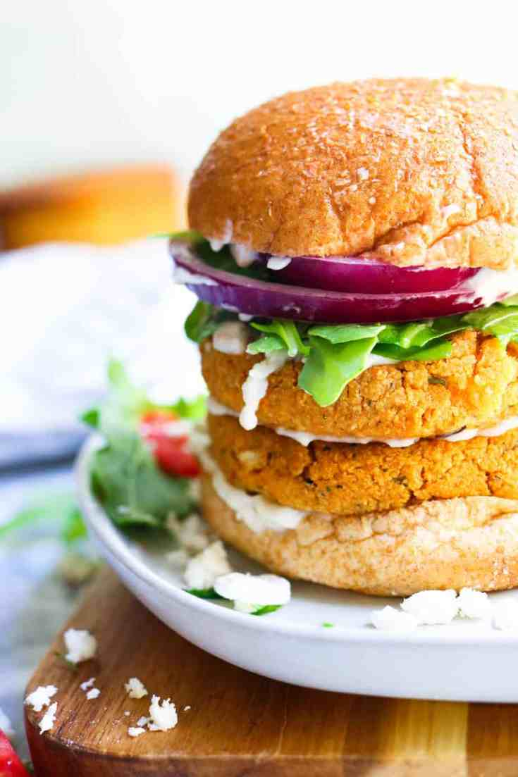 Hearty chickpeas, fluffy riced cauliflower, vibrant sundried tomatoes and fresh parsley formed into these delicious, sturdy veggie burgers that will soon become your new favorite veggie burger!, #veggieburger, #easyrecipes, #chickpeas, #cauliflower, #quinoa