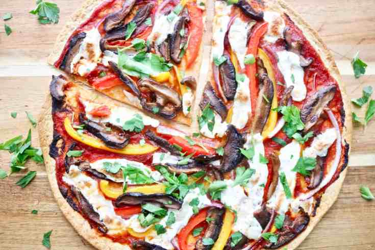 Low carb tortilla pizza loaded with veggies, topped with fresh mozzarella cheese and baked until the tortilla crust is nice and crispy on the edges. This guilt-free pizza option is calling your name! Low in fat, low in carbs but high in flavor and deliciousness! Ready in 15 minutes! Easy weeknight meal! #lowcarbpizza #tortillapizza #easyweeknighmeals #readyin15minutes #healthypizza