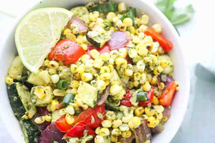 Perfectly grilled sweet corn, roasted zucchini, peppers and onions mixed with an amazing Cilantro Lime Dressing that you need in your life! Vegan, Gluten-Free and Kid-Friendly! #grilledcornsalad #roastedveggies #easyspringsalad #zucchini #cilantrolimedressing