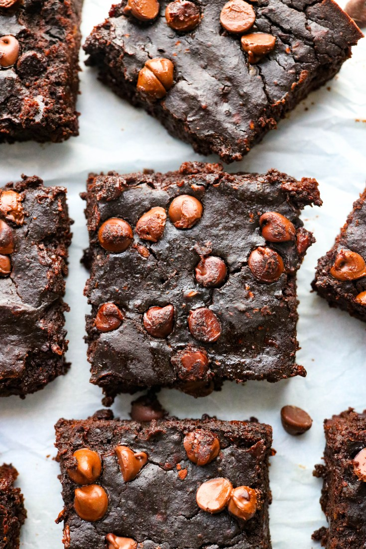 Healthy Black Bean Avocado Brownies that are so simple, and unbelievably fudgy and decadent. The batter is made completely in the food processor with hearty black beans, creamy avocado, eggs, cocoa powder, a little sugar, vanilla, and of course chocolate chips. These brownies will be everyone's new favorite. Plus they are gluten-free! #blackbeanbrownies #blackbeans #avocados #healthybrownierecipes
