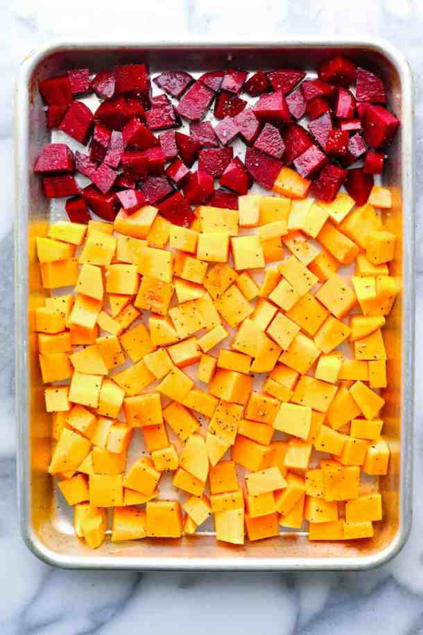 Beets and squash cubed on a sheet pan.