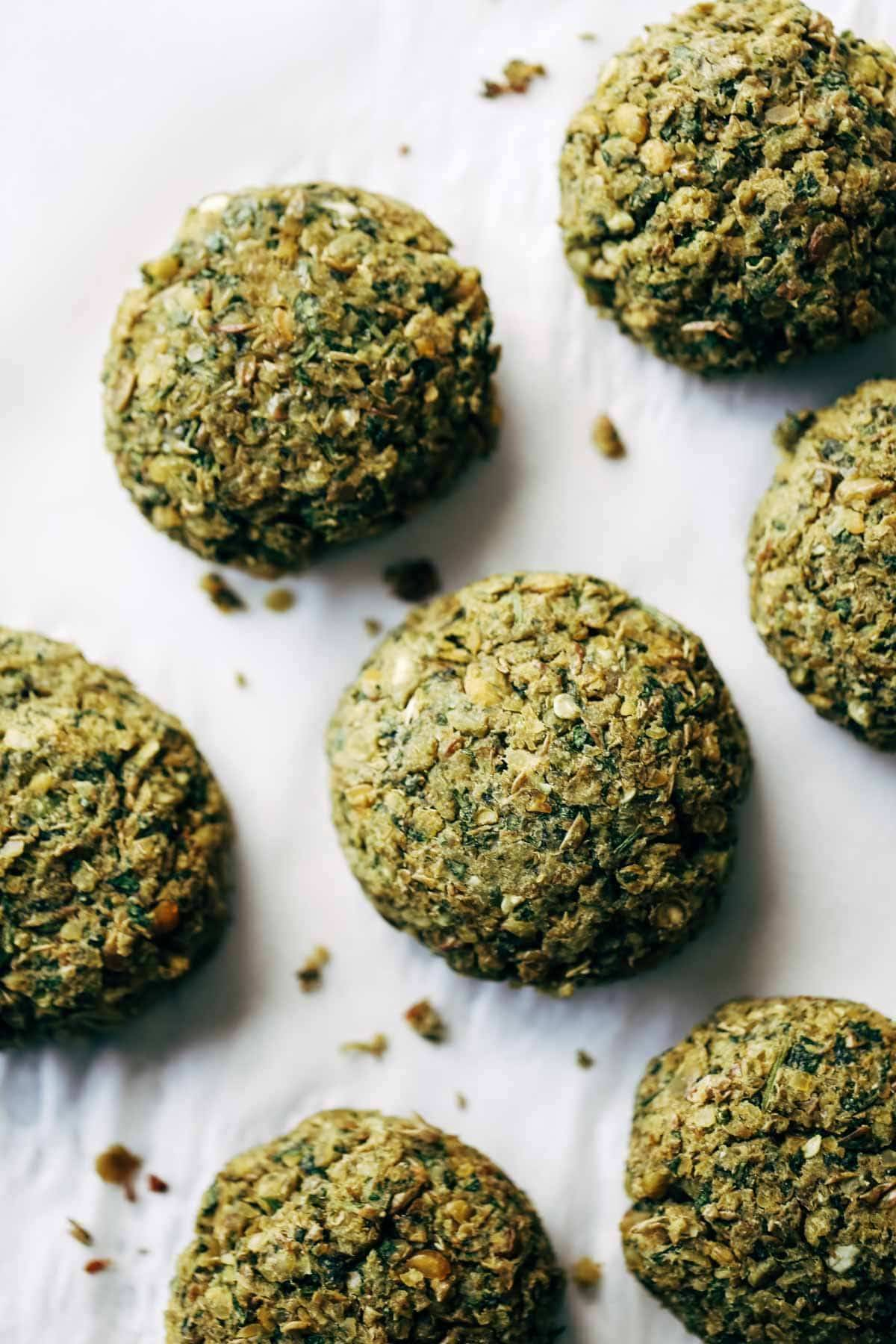 Easy baked falafel at home in 30 minutes WITHOUT deep frying! Features lentils, herbs, garlic, lemon juice. Use in salads, sandwiches, healthy recipes. | pinchofyum.com