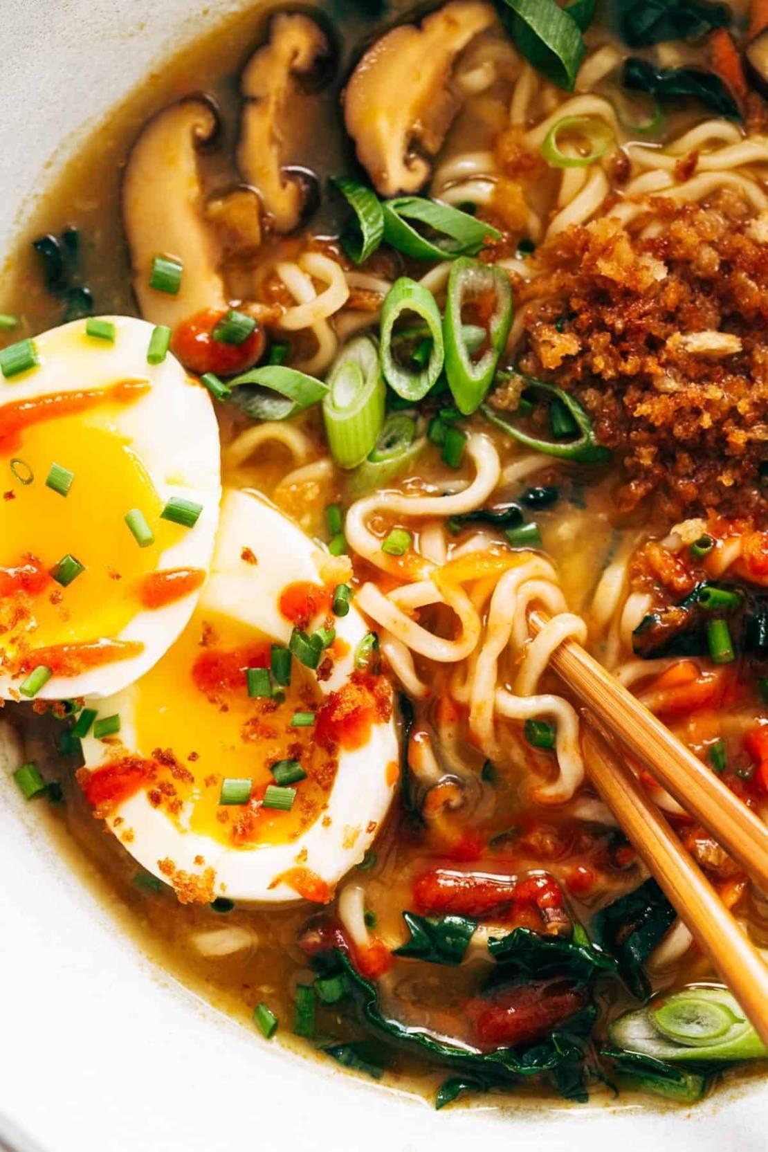 Close-up image of Quick Homemade Ramen with chopsticks and a soft egg.