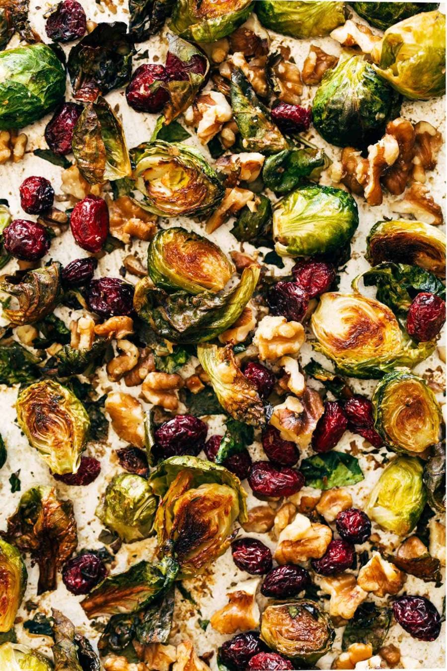 Close-up of Brussels sprouts on pan with walnuts and cranberries