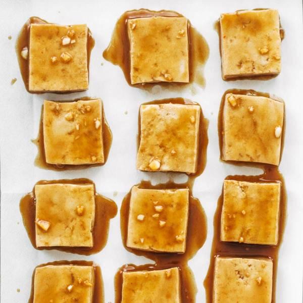 Marinated tofu on baking sheet.