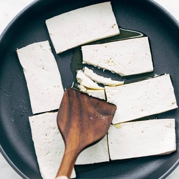 Tofu in a pan with oil.