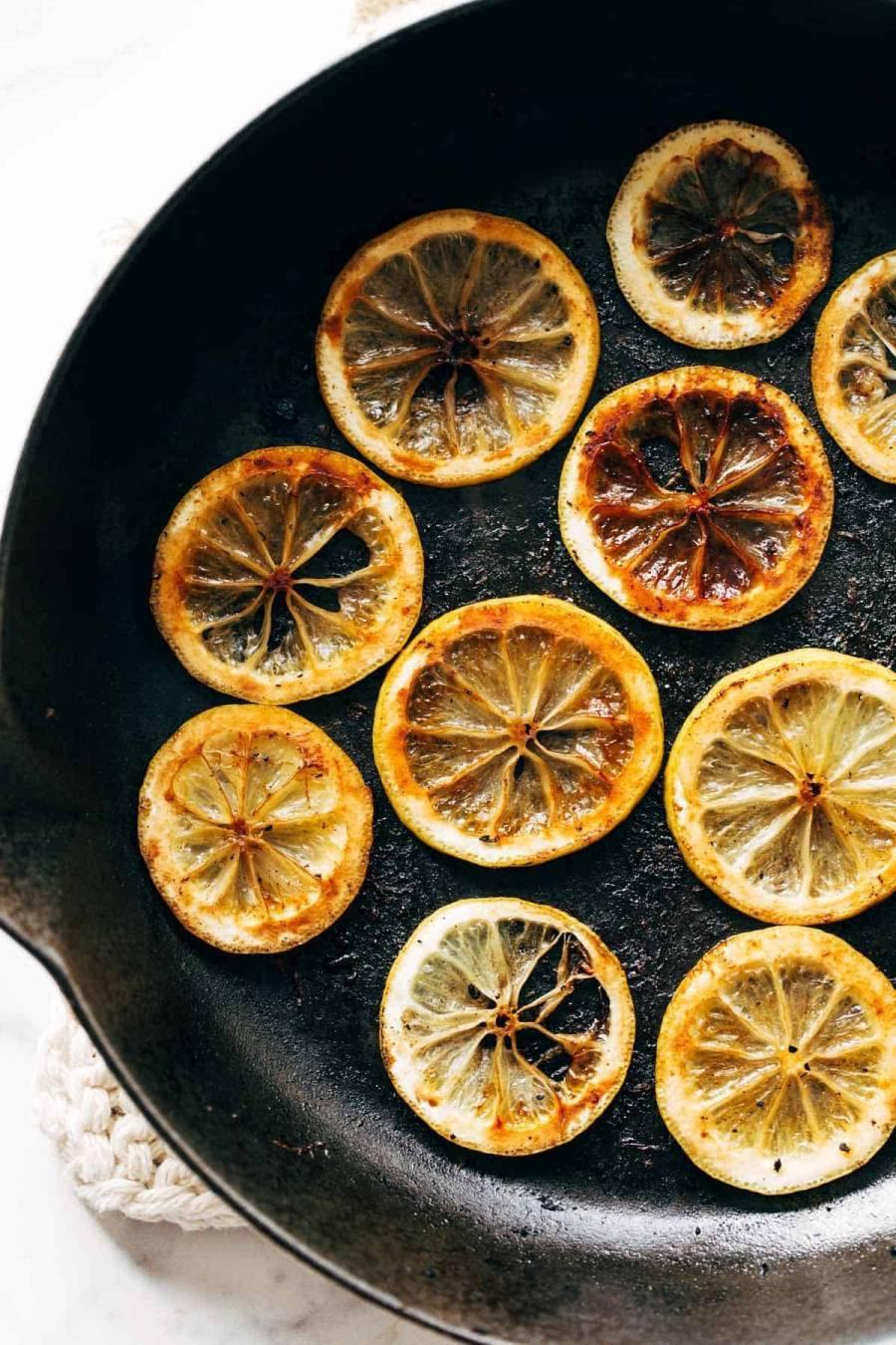 Sauteed lemons in a pan