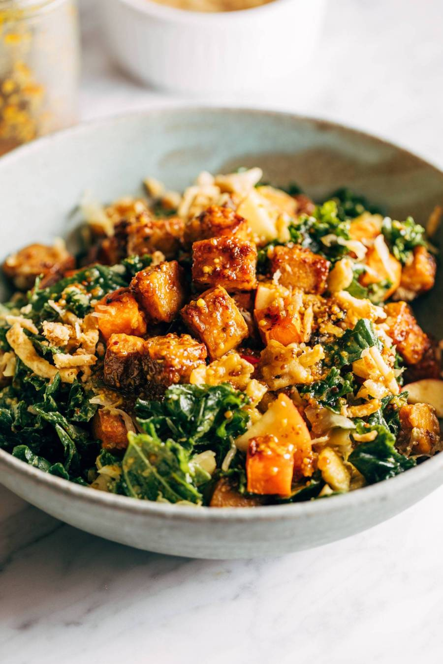 Maple mustard tempeh bowls in a grey bowl.