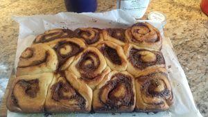 cinnamon rolls in pan before icing