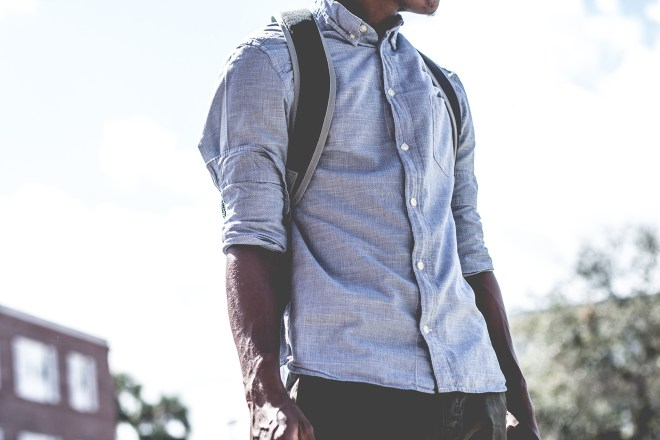 Man wearing a shirt and a backpack