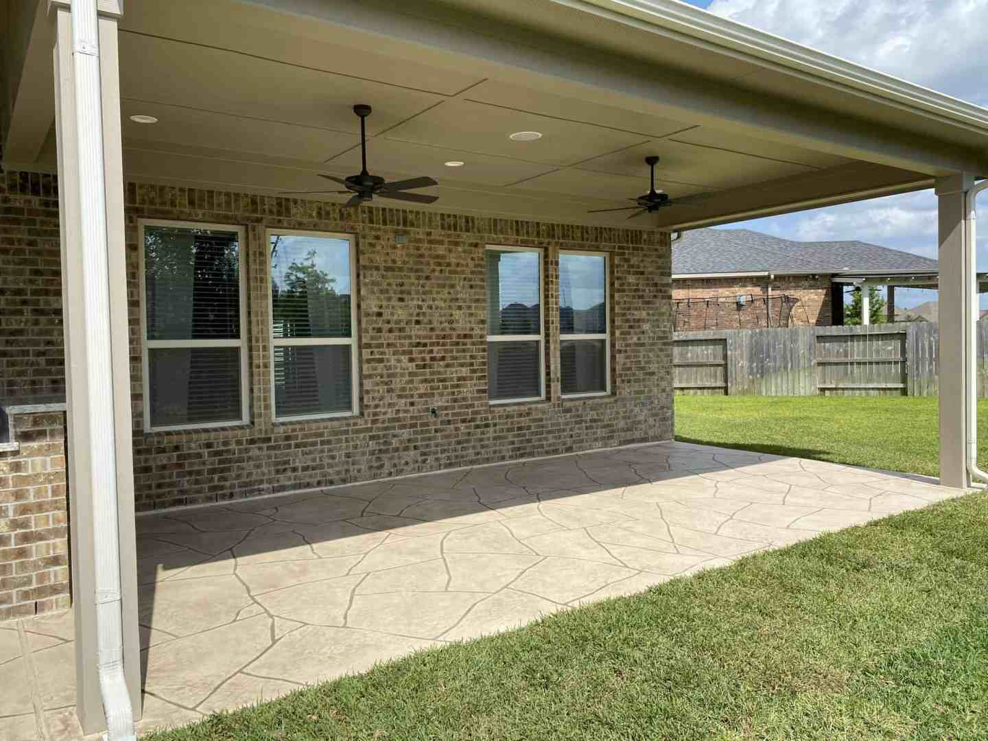 Back-Patio-Extension-Matts-Custom-Decks-stamped-concrete