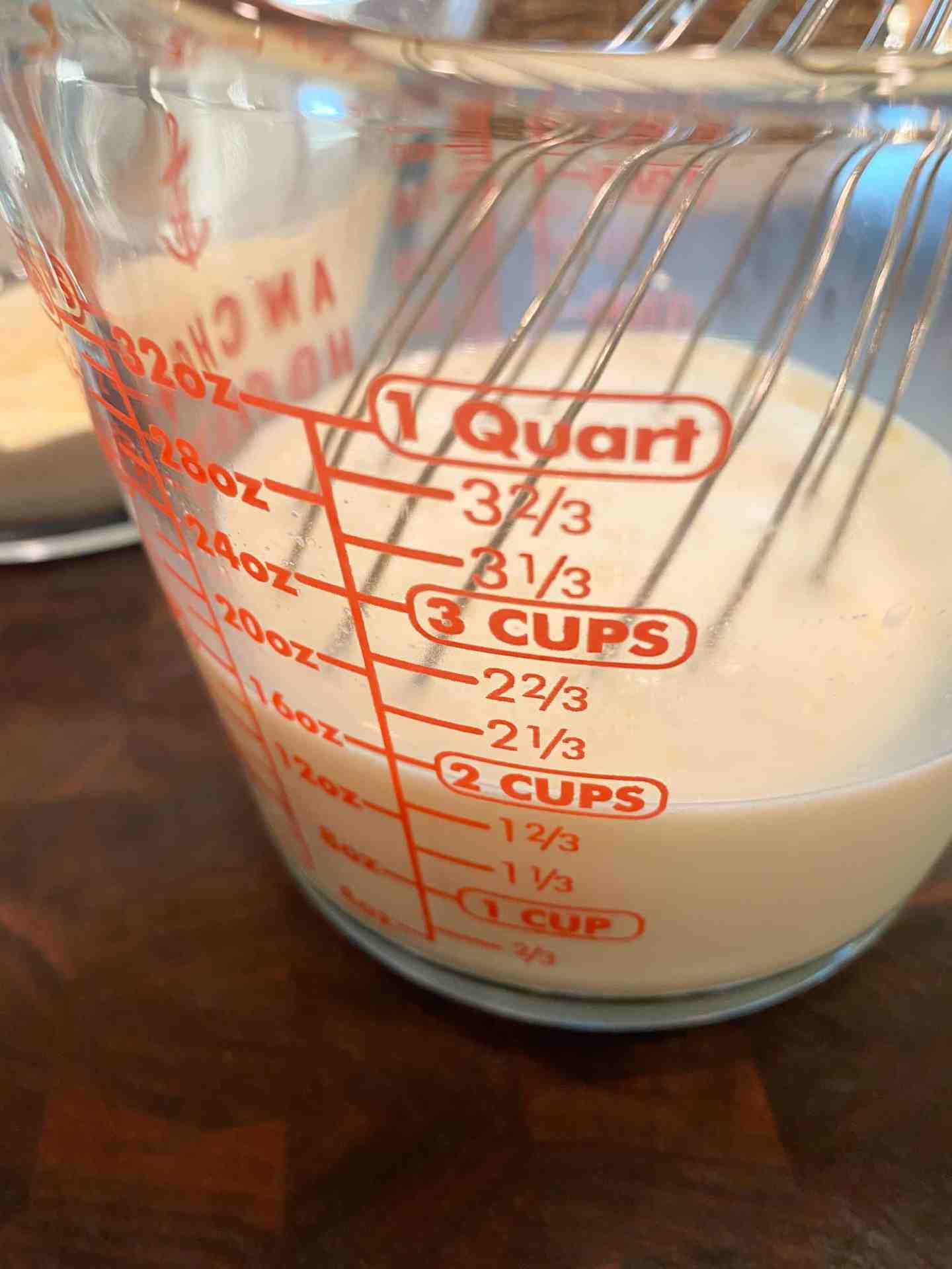 whisk-together-buttermilk-and-milk-in-a-large-measuring-cup