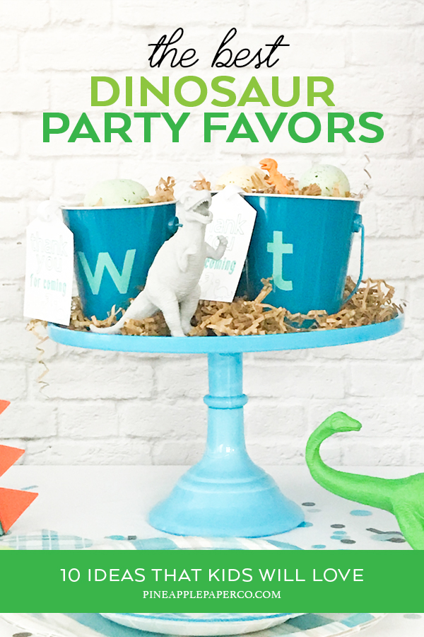 Dinosaur Favors on a Blue Cake Stand - Dinosaur Favor Ideas curated by Pineapple Paper Co.