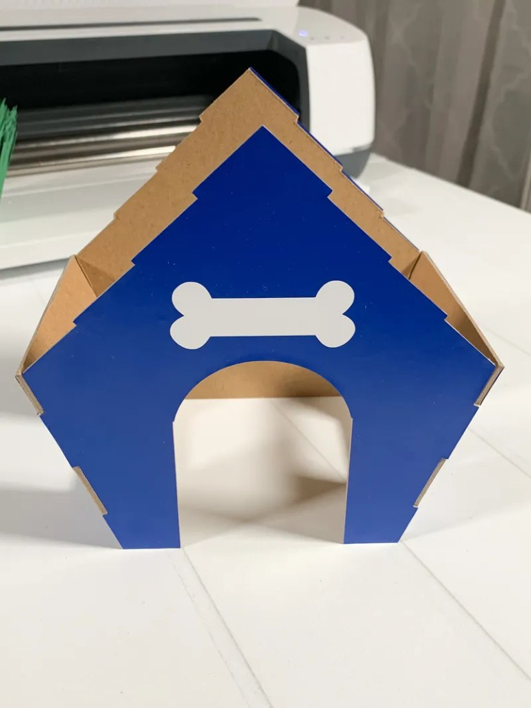 3D Doghouse made with Cricut Chipboard and Vinyl using Cricut Maker for Puppy Birthday Party Favor Pineapple Paper Co.