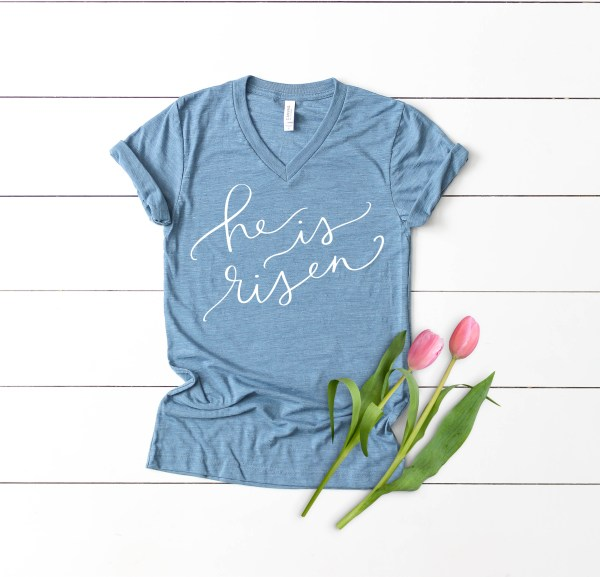 He is Risen Religious Easter SVG on Blue Shirt by Pineapple Paper Co.