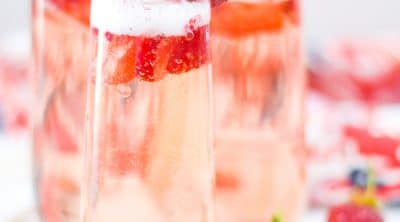 Strawberry Bellini with Fresh Sliced Strawberries and Whole Strawberry Garnish
