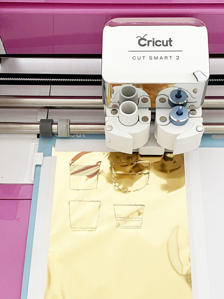 Cricut Explore Air 2 applying foil to plant art prints