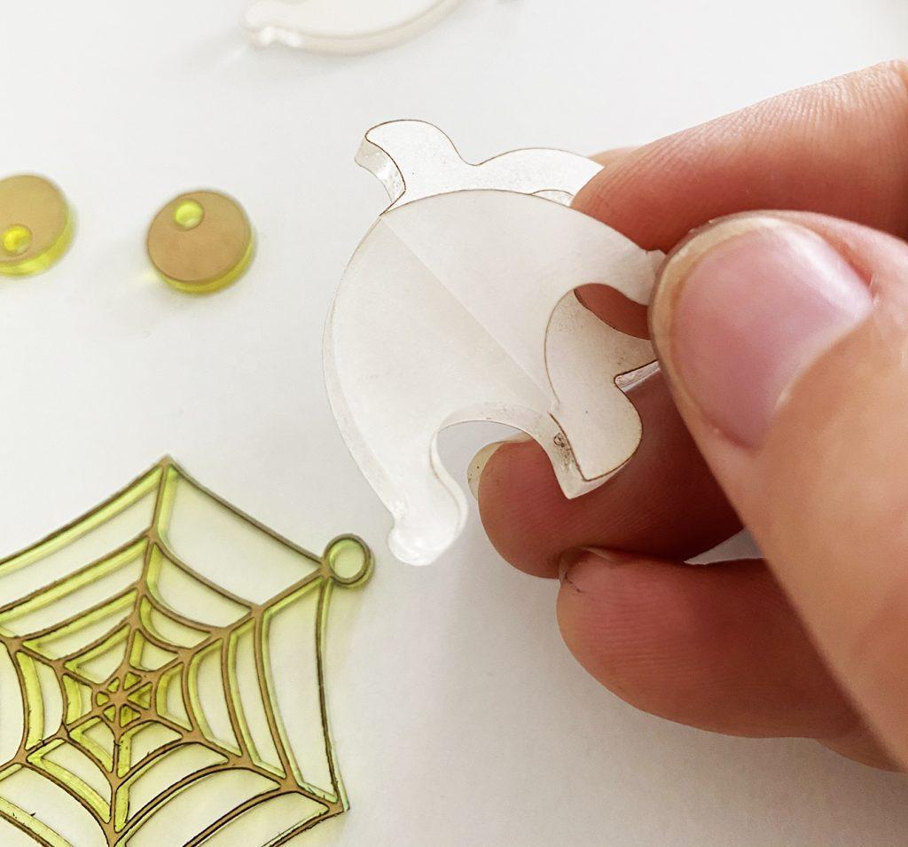 Peeling Mask off of DIY Acrylic Ghost Earrings on Glowforge