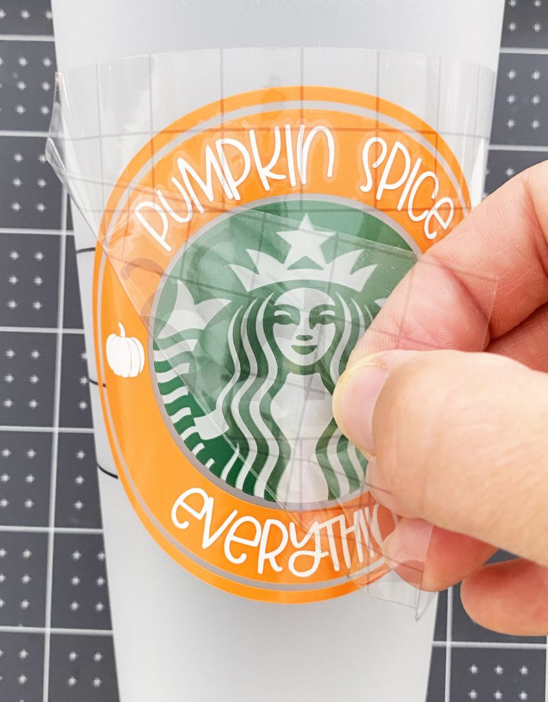 Applying Pumpkin Spice Vinyl Decal to Starbucks Cold Cup