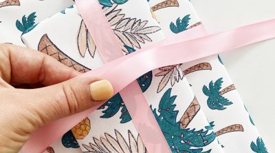 Tying Ribbon on Printable Wrapping Paper from Pineapple Paper Co.