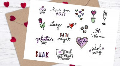 Free Printable Valentine Stickers on White card with Kraft Paper Envelope and Red Heart Confetti