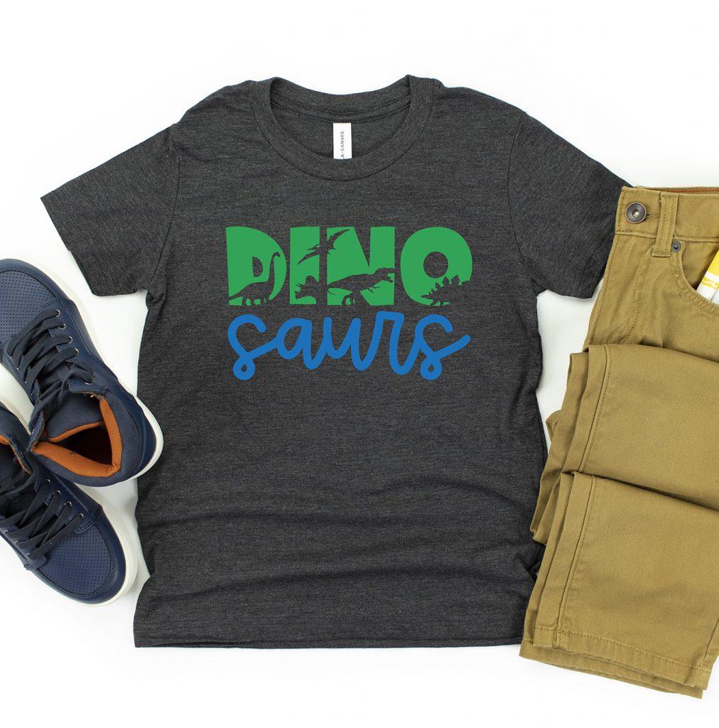 Free Dinosaur SVG on Gray Shirt with Green and Blue Cricut Iron On Vinyl