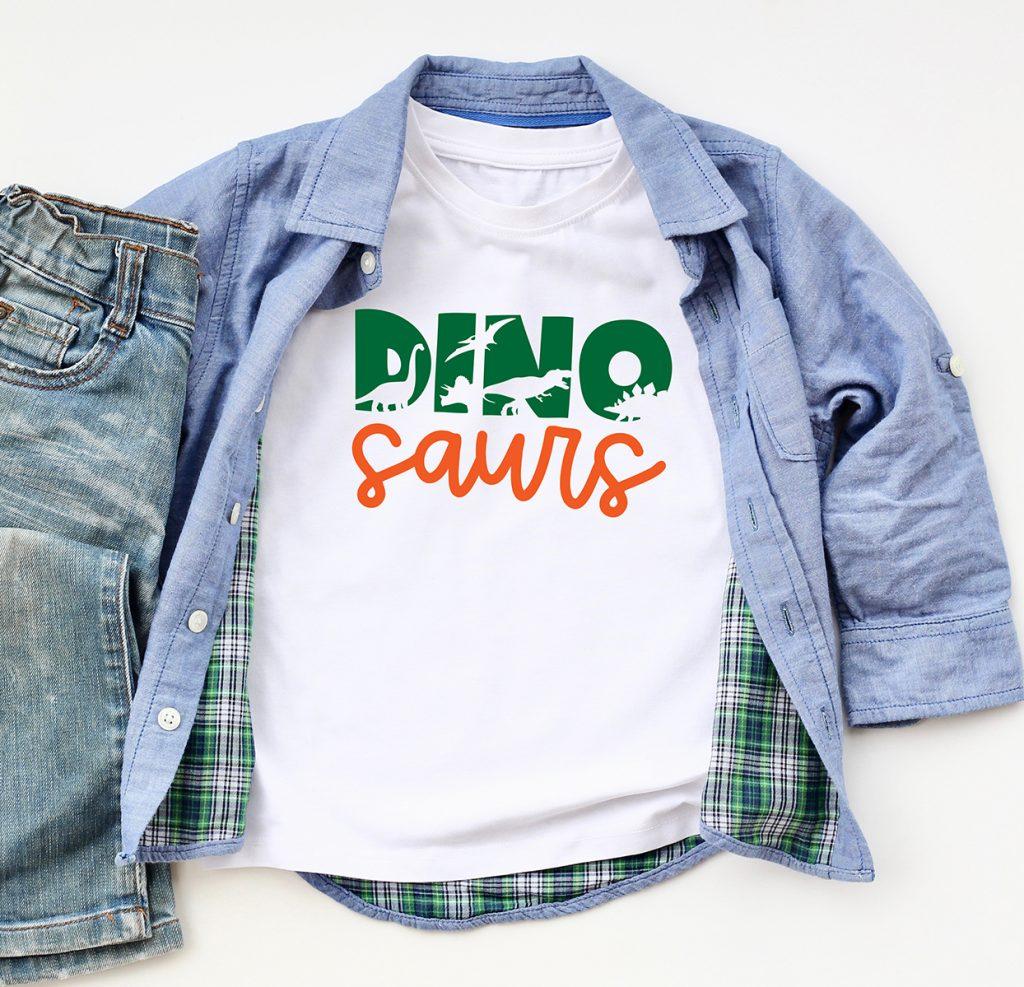 Free Dinosaur SVG on White Shirt with Green and Orange Cricut Iron On Vinyl