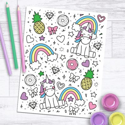 Unicorn Coloring Page Free Printable on Paper Background with Colored Pencils and Paint