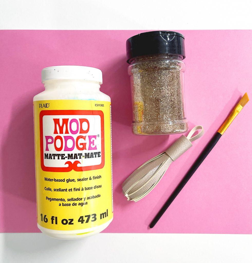 Mod Podge and Glitter to Make DIY Glitter Leather Tassel