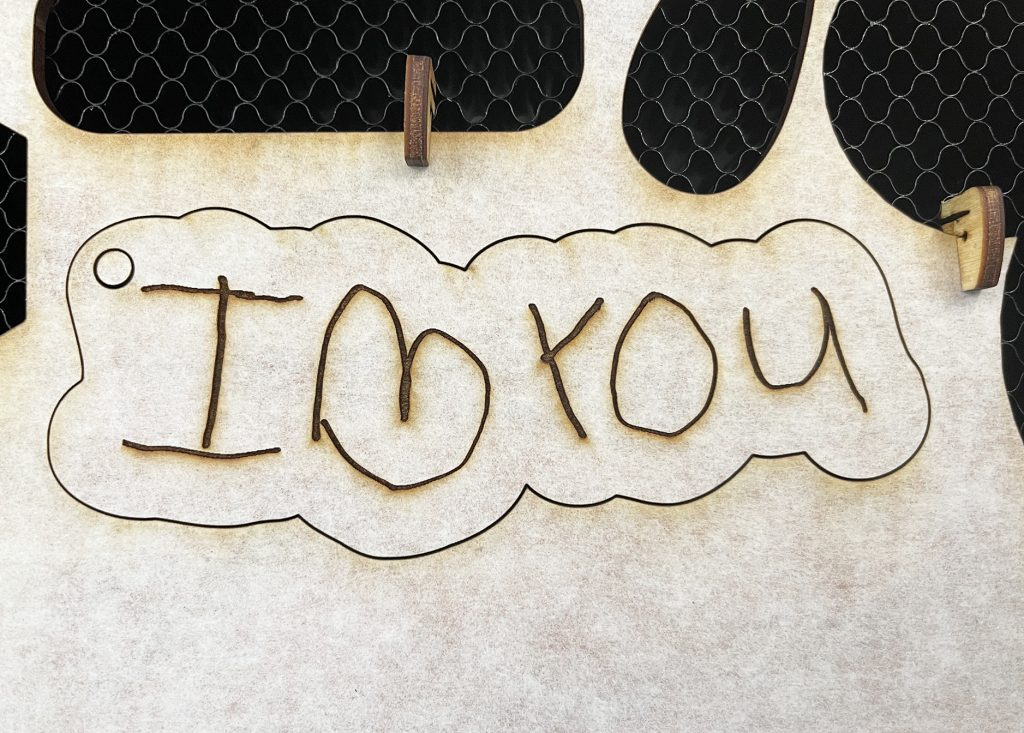 DIY Laser Cut Wood Keychain with I Love You in Toddler Handwriting Made with Glowforge