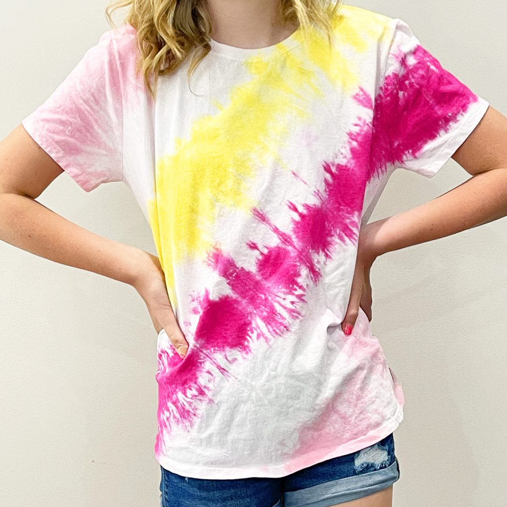Girl in DIY Tie Dye Shirt with Pink and yellow diagonal stripes