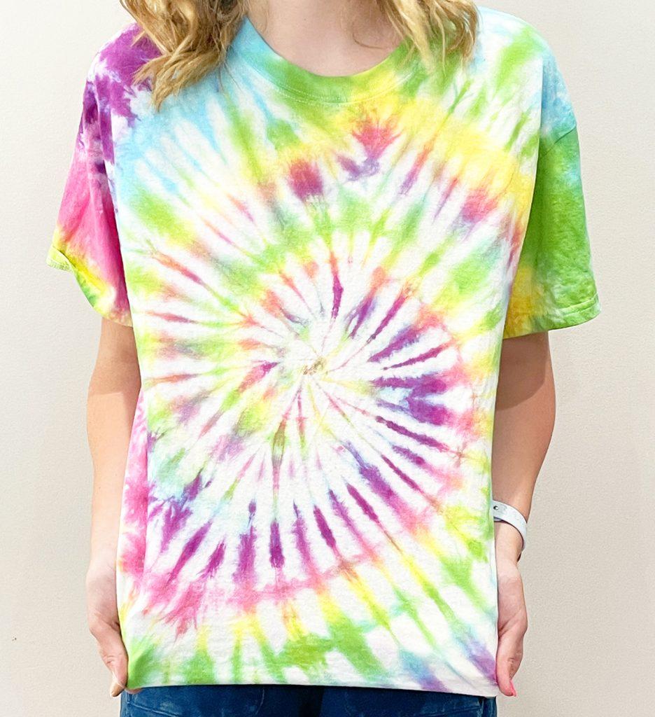 Girl in Rainbow Spiral Tie Dye Shirt