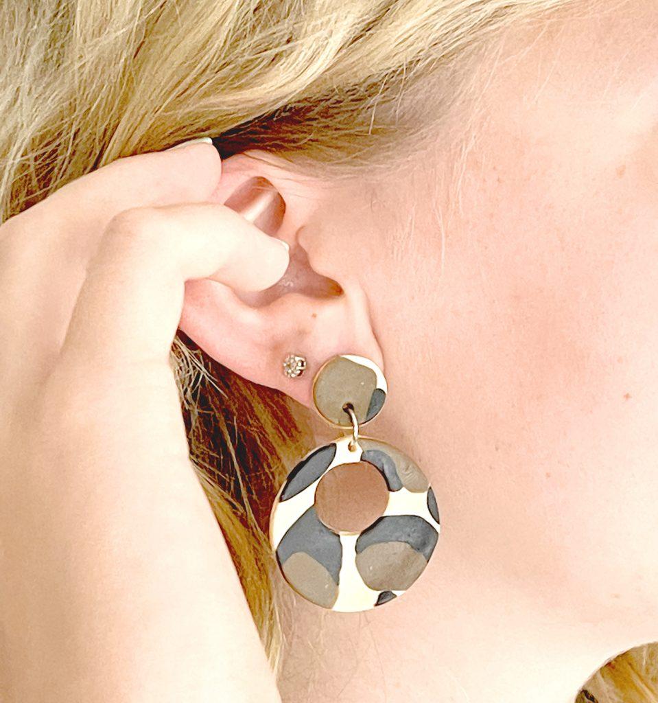 leopard print polymer clay earrings in ear