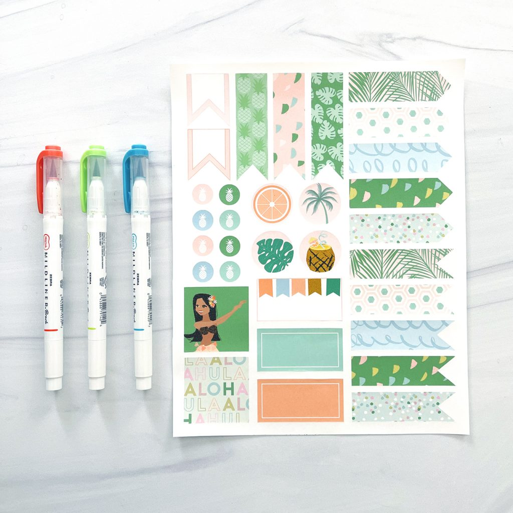 Printable Planner Stickers for summer with 3 mildliners on white marble countertop
