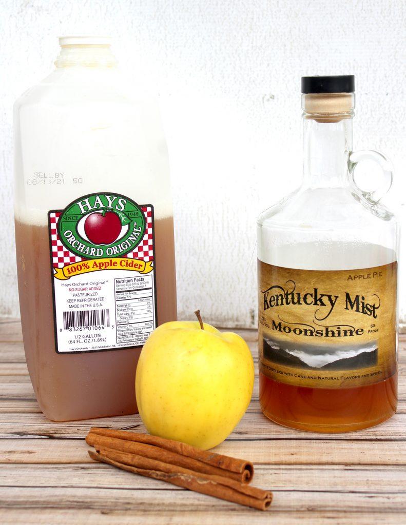 Apple Cider, Apple Pie Moonshine, Apple, and Cinnamon Sticks for Apple Pie Moonshine Cocktail Recipe
