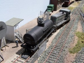 The yard loco shunts a tank car