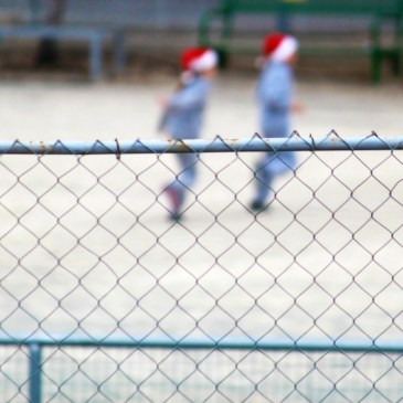 """Last day at school before Christmas: through the fence"" – A Photo Essay."