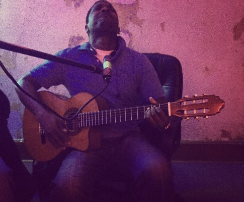 Fenner plays his guitar and sings soulfully at Pinetop Recording Studio.