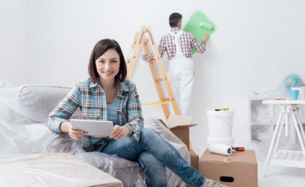 Men doing Home renovation and Women measuring the work - Pinetree Financial