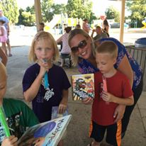 Mrs. Schut, Pinewood Office Assistant, and her kids enjoying books and popcicles