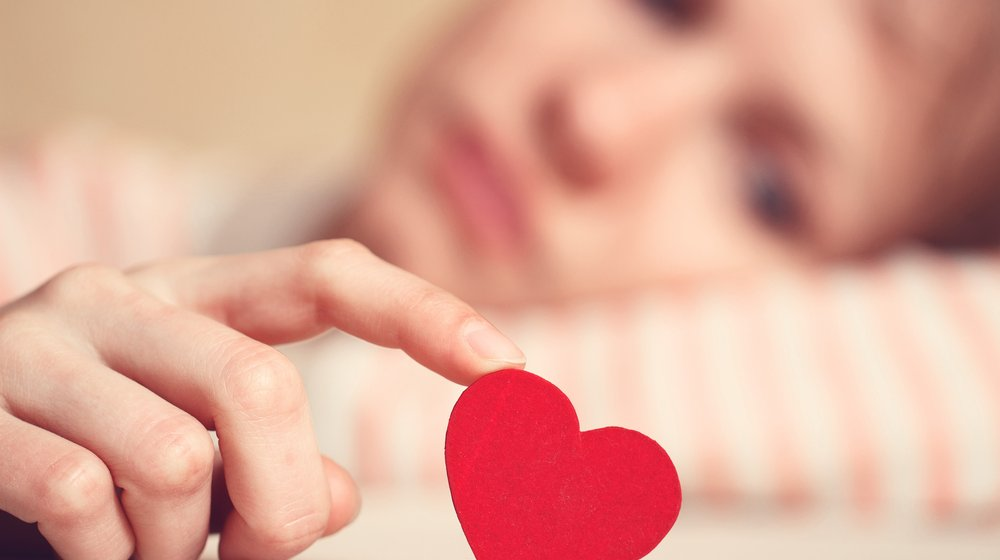 woman-in-love-holding-a-paper-heart--1000x560