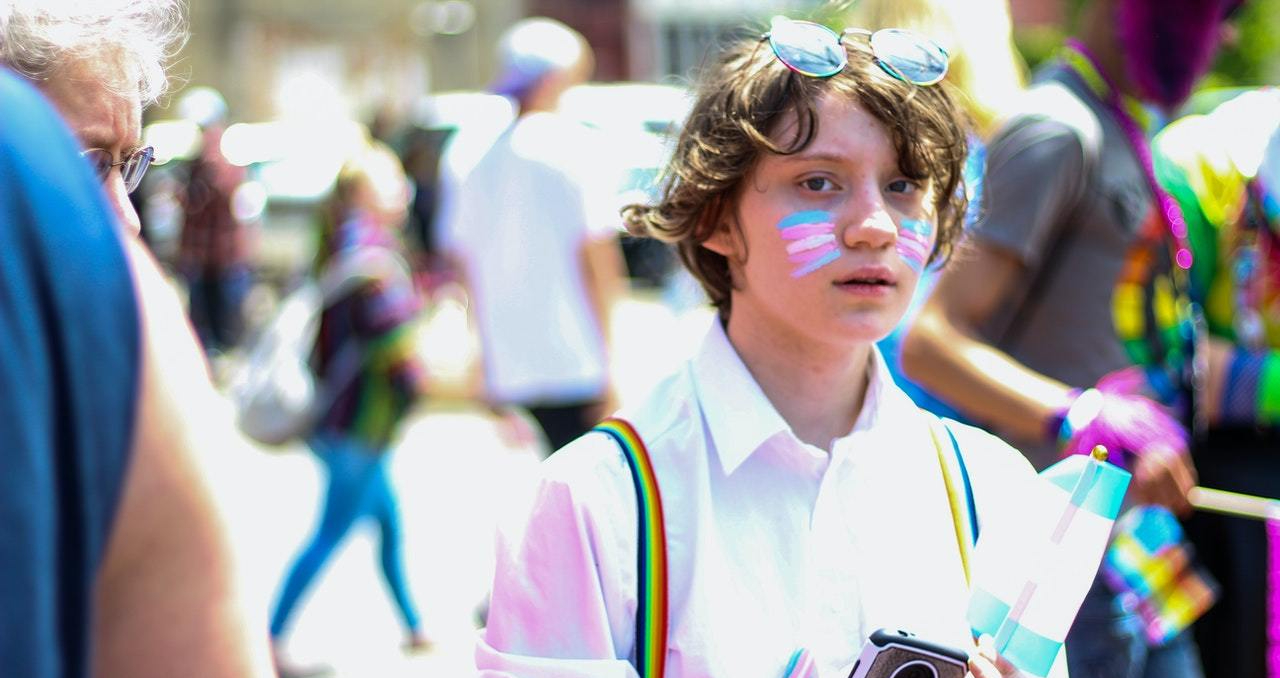 trans rainbow young youth flag march