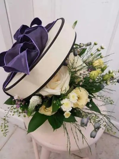 hatbox flower arrangement by pink and perfect florists