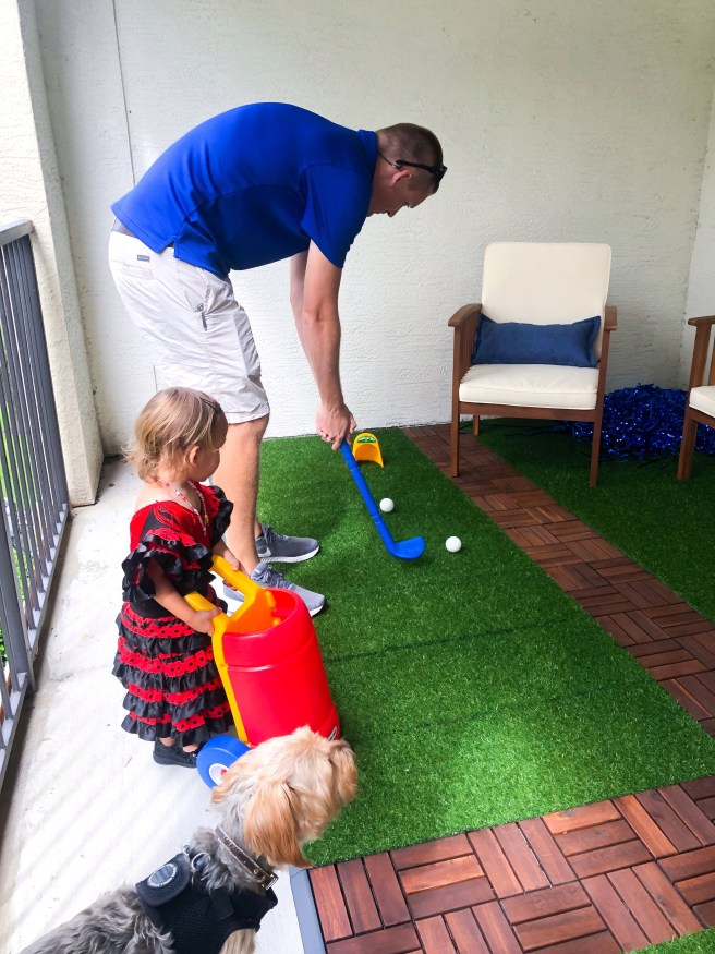 Party guests playing golf - Pink Bows & Twinkle Toes