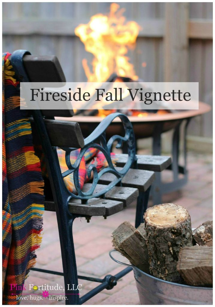 Fall means the leaves are changing. Fall is walking out into the crisp air. Fall is wearing boots and a sweater. And for today's fall vignette, Fall is a cozy blanket and a fire. Grab a cup of cocoa and snuggle up with the Bertones!