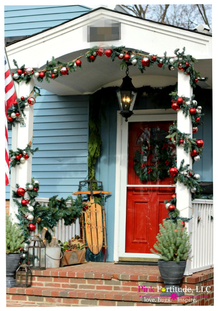 We moved to the Homestead a few weeks before Christmas in 2011. The nesting instinct hit instantly as we moved into our dream home and I HAD to adorn the pillars of our front porch with the Pottery Barn garland. It's morphed a bit over the last couple years, and this is how our Christmas porch welcomes us home.
