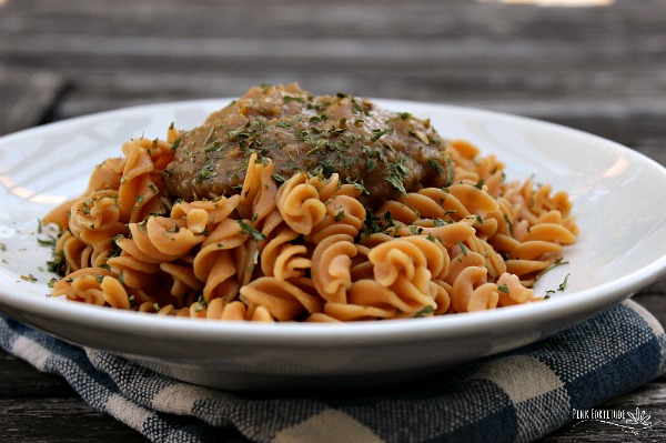 Plate of gluten free pasta topped with savory pumpkin sauce